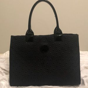 Tory Burch quilted tote with patent straps.
